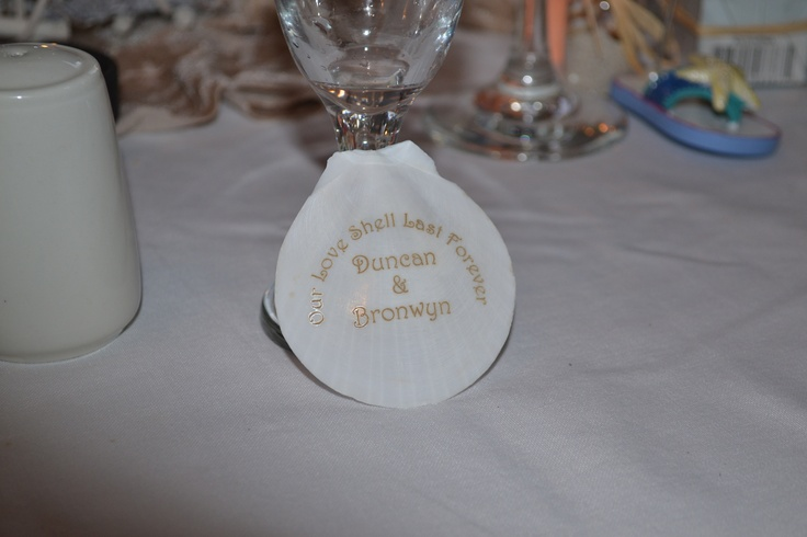 """Sea shell as a wedding favour engraved with """"Our Love Shell Last Forever"""""""