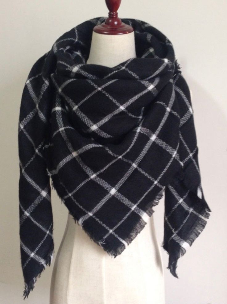This extra soft scarf is perfect to keep you warm and stylish the whole winter and fall season. This scarf is plaid with black, and white. Size: 55 inches by 55 inches