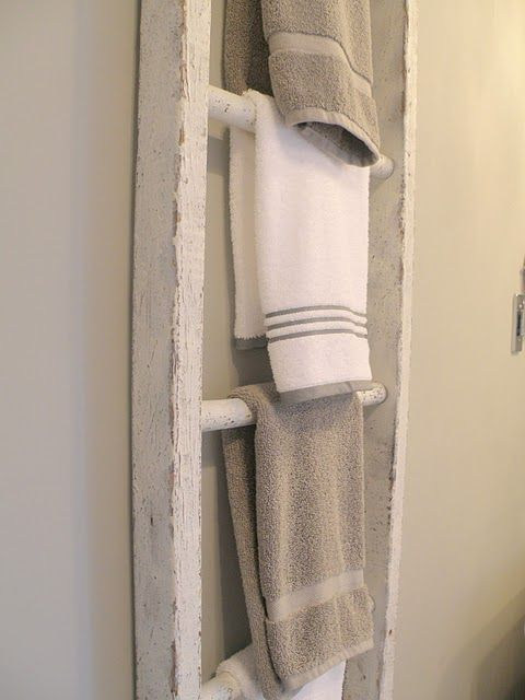 Ladder towel holder is ingenious and thrifty! This would be a great possibility for my cottage bathroom!