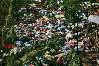 The Sorrowful Story of the Jonestown Massacre: Dead bodies litter the ground after a mass suicide of the People's Temple cult followers.