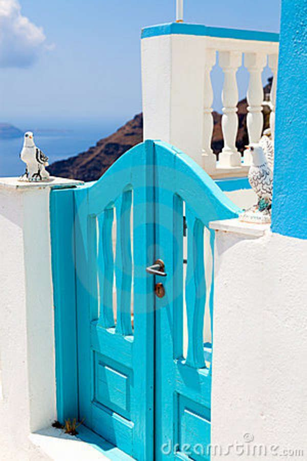 Old turquoise colored wooden gate in Thira, Santorini, Greece