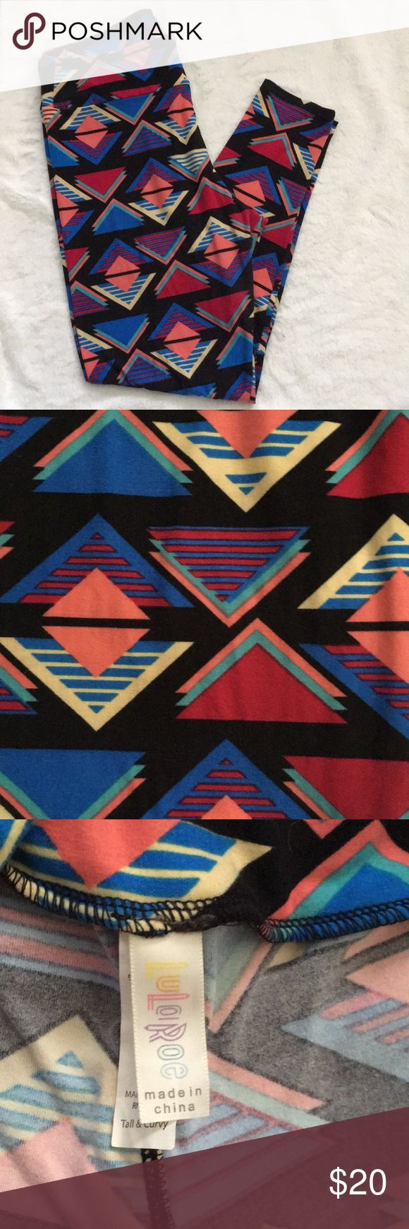 Geometric Print LuLaRoe TC Leggings Black LuLaRoe TC leggings with various colored (blue, green, yellow, orange, red) triangles.  Some triangles are solid and some are striped.  EUC with minimal signs of wear between the legs.  Super soft, made in China. LuLaRoe Pants Leggings