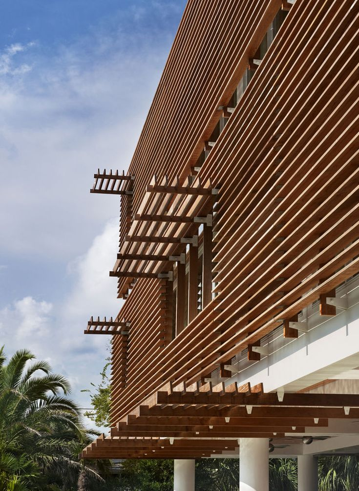 exterior louver. modern interpretation of a charleston single clad in ipe wood louvers that encourage cross breeze exterior louver