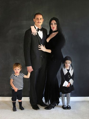 The Addams Family - They're creepy and they're kooky... We can't think of a more fitting (and totally creepy) family costume than this. Little Pugsley and Wednesday are beyond adorable. And the hand on dad's shoulder is spookily good touch. 11 Scary-Good Themed Costume Ideas