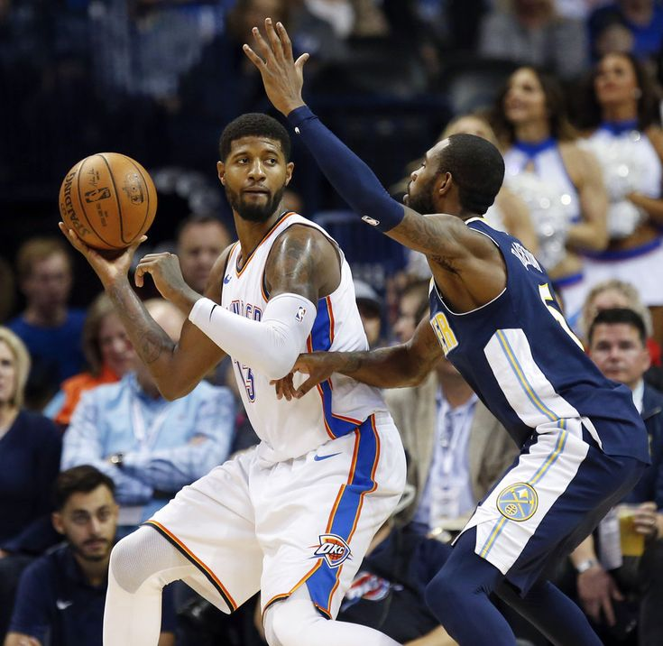 Oklahoma City\'s Paul George (13) looks to pass around Denver\'s Will Barton (5) during an NBA basketball game between the Oklahoma City Thunder and the Denver Nuggets at Chesapeake Energy Arena in Oklahoma City, Monday, Dec. 18, 2017. Oklahoma City won 95-94. Photo by Nate Billings, The Oklahoman