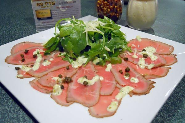 ... arugula salad and jalapeño aioli garnished with fried capers and