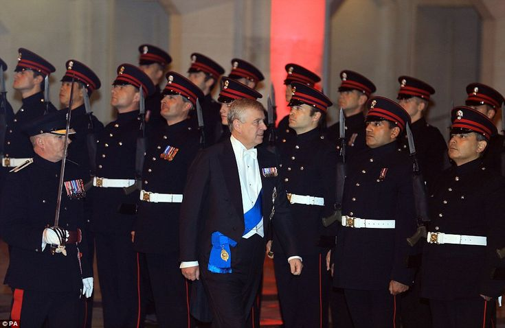 The Duke of York, Prince Andrew, inspects a guard of honour as he attends the Lord Mayor's banquet at the Guildhall in London tonight
