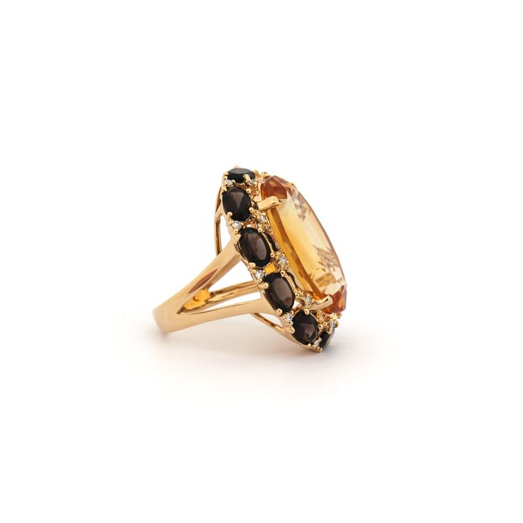 EAU DE VIE RING | This glamorous ring is made with a spectacular centre stone of Citrine, surrounded by a ring of smokey quartz and diamonds set in 18 karat yellow gold.