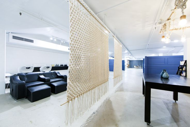 Custom made macrame dividers offer a sanctuary while relaxing at the basin area – #AFOH #aflickofhares #interiordesign #salondesign #hairsalon #nordicindustrial #minimalistdesign #idustrialchic #nordicdesign #macrame