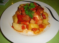 salmon baked in the oven with tomato and onions