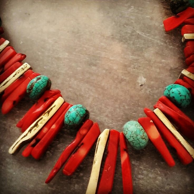 DETAIL OF A GOLD NECKLACE WITH CORAL AND TURQUOISE. OURANIA JEWELLERY