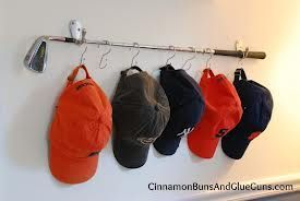 How to organize baseball hats. My husband would love this. Maybe I'll claim it as an original idea ;)