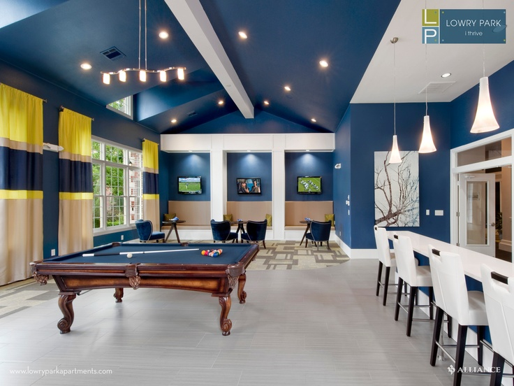 Clubhouse with billiards table at Lowry Park Apartments in Denver, CO. Beautiful blue paint color, looks great with the skylights.
