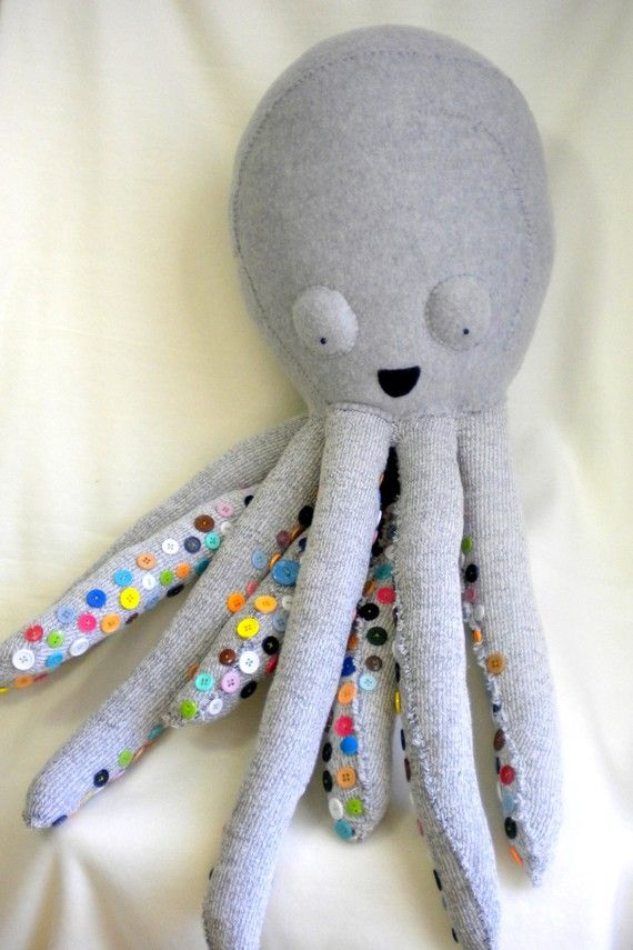 Toy octopus with buttons on underside of tentacles. Could easily be recreated with a knitted one. (Originally saw this as a more popular pin linked to tumblr but always want original source to credit when available.)
