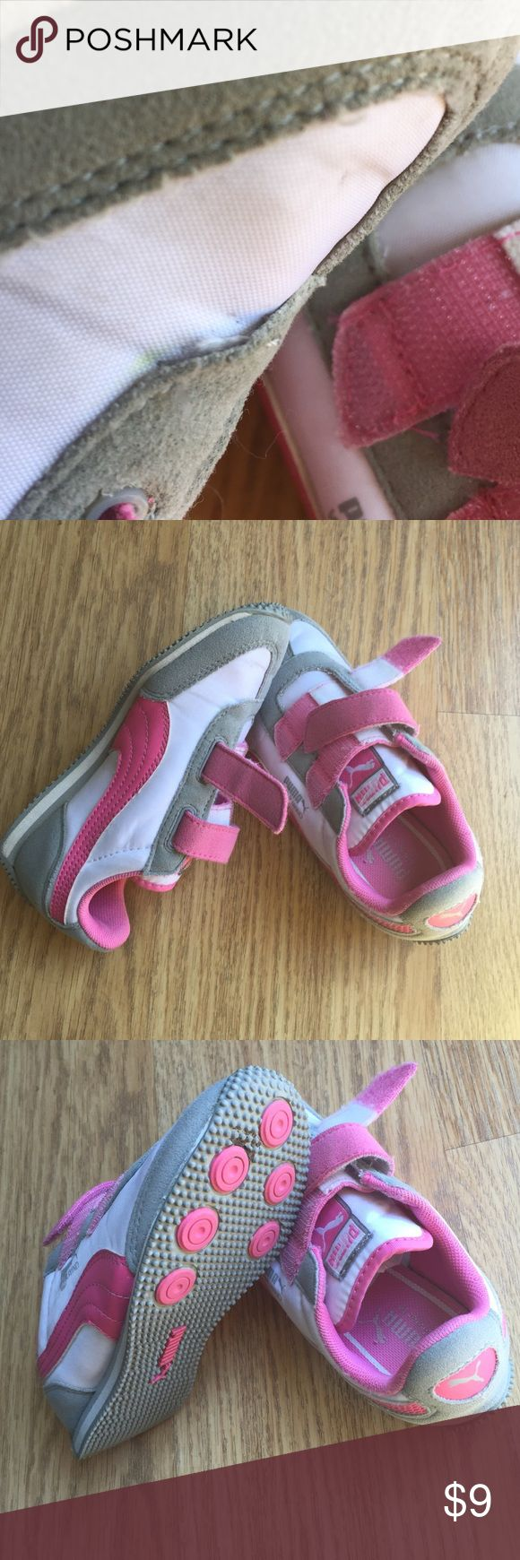 Pink Puma sneakers for girls. Infant size 12 Pink Puma Sport Sneakers in clean condition, size 12 for a child. The right has about two seams lines broken but in strong reusable condition. Normal signs of used at soles. Puma Shoes Sneakers