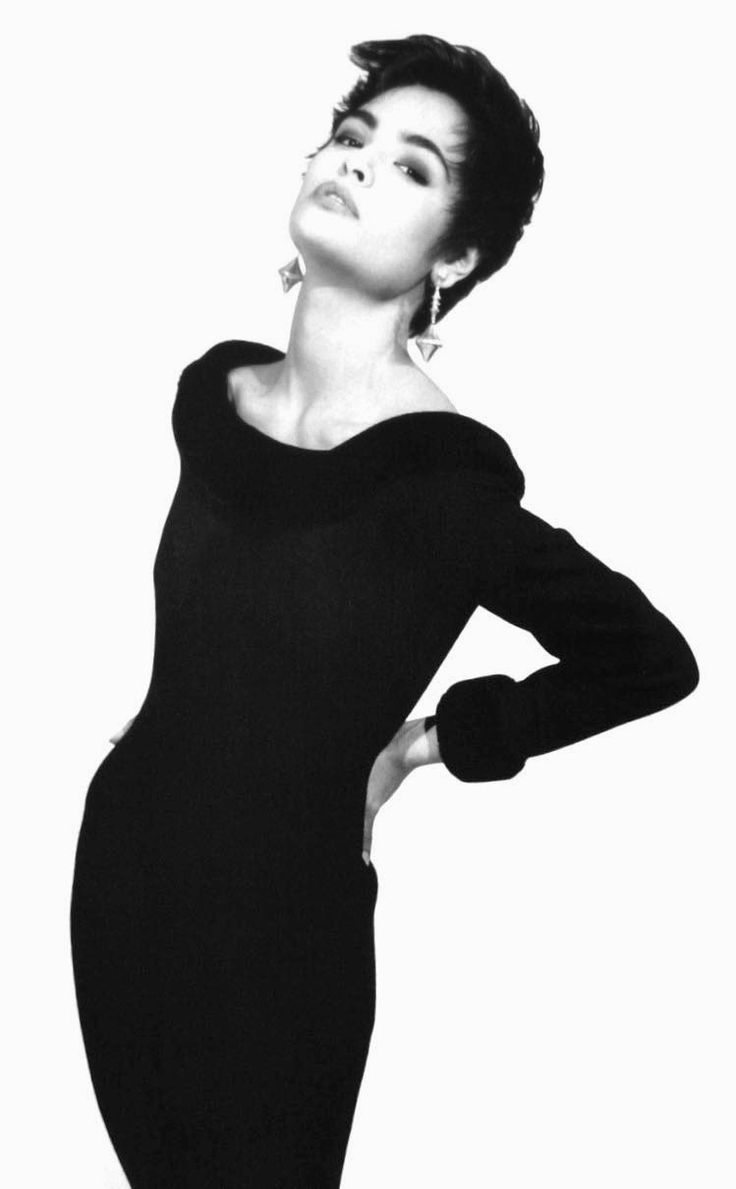 Talisa Soto in a black wool dress with fake fur collar and cuffs by Arabella Pollen, photo Michael Roberts, Tatler UK July/August 1987
