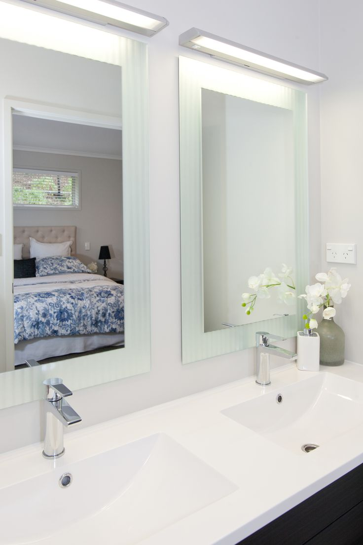 Twin mirrors and basins in the master bedroom ensuite bathroom!