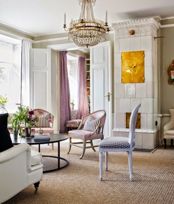 white walls, french touches and a crystal chandelier