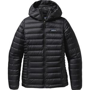 From late-fall belays to powder-filled days, the figure-flattering Women's Down Sweater Full-Zip Hooded Jacket from Patagonia slips under a wind-blocking vest or a weatherproof shell and acts as a warming, low-bulk mid-layer. It also packs up small for travel and works as a top layer for Chicago shopping forays. Down insulation packs a powerful punch of heat without weighing heavily on your shoulders or taking up any more space than, say, your Jack Russel terrier. Recycled polyester ripstop…