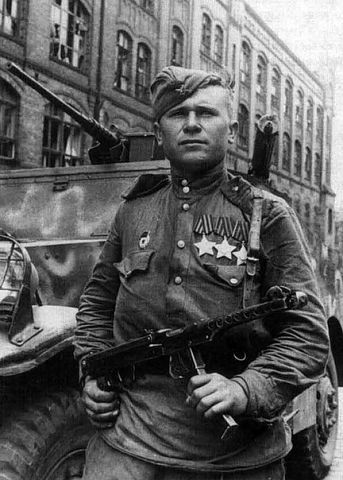 Soviet soldier capturing a German hiding in a basement