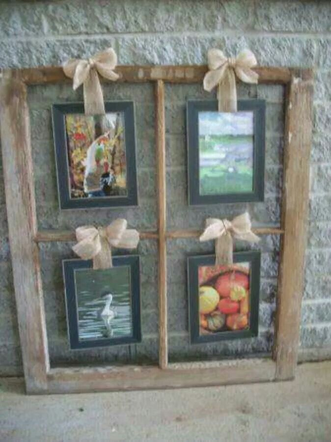 Old wooden window frame used as a picture frame. So chic & rustic. Using this at my wedding!