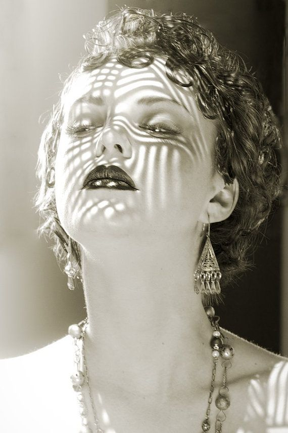 black and white portrait of a lady with shadow on her face