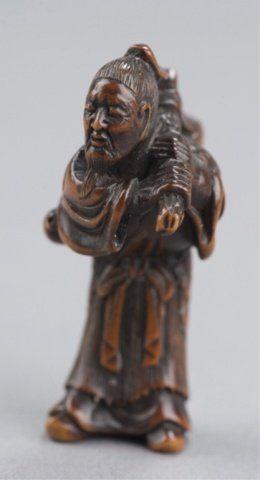 14: A wood netsuke of a bent over sennin. : Lot 14