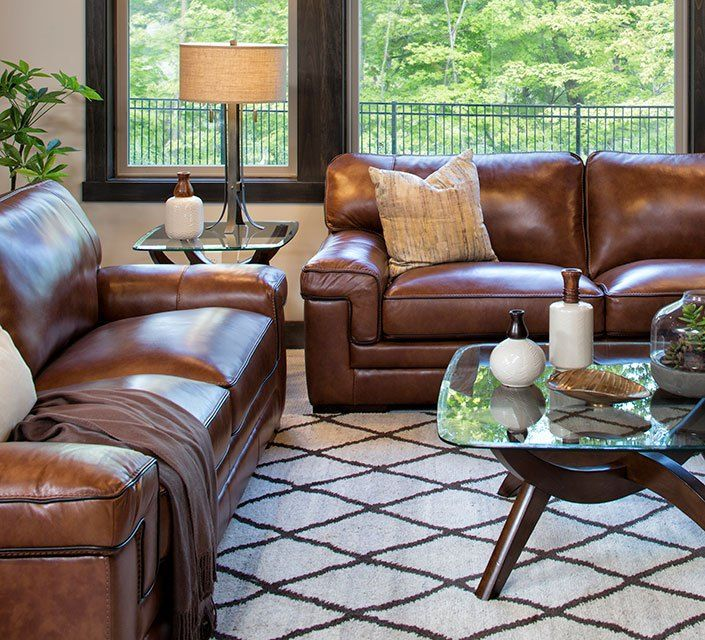 This Minnesota Casual family room is approachable and oh-so-comfortable, but definitely not lacking in style. We love the look!.