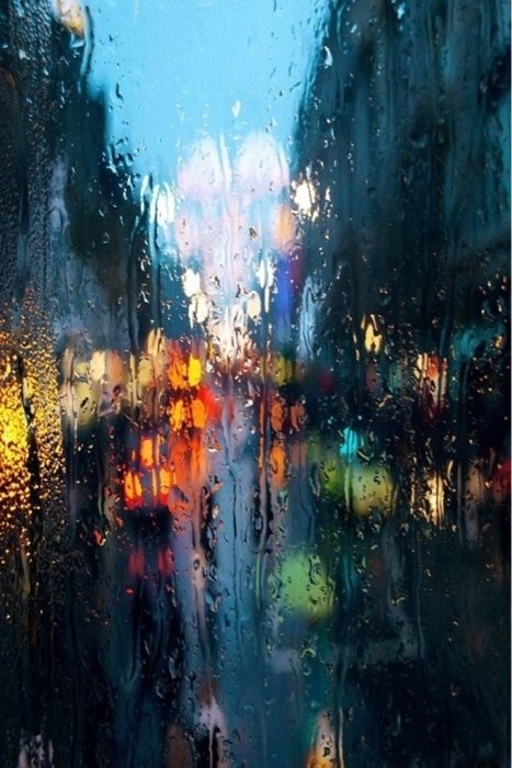 water colors through rain drenched glass