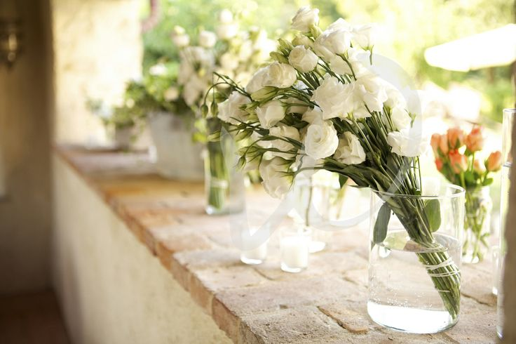 Recicled vases and white lusiantus for the wedding decorations