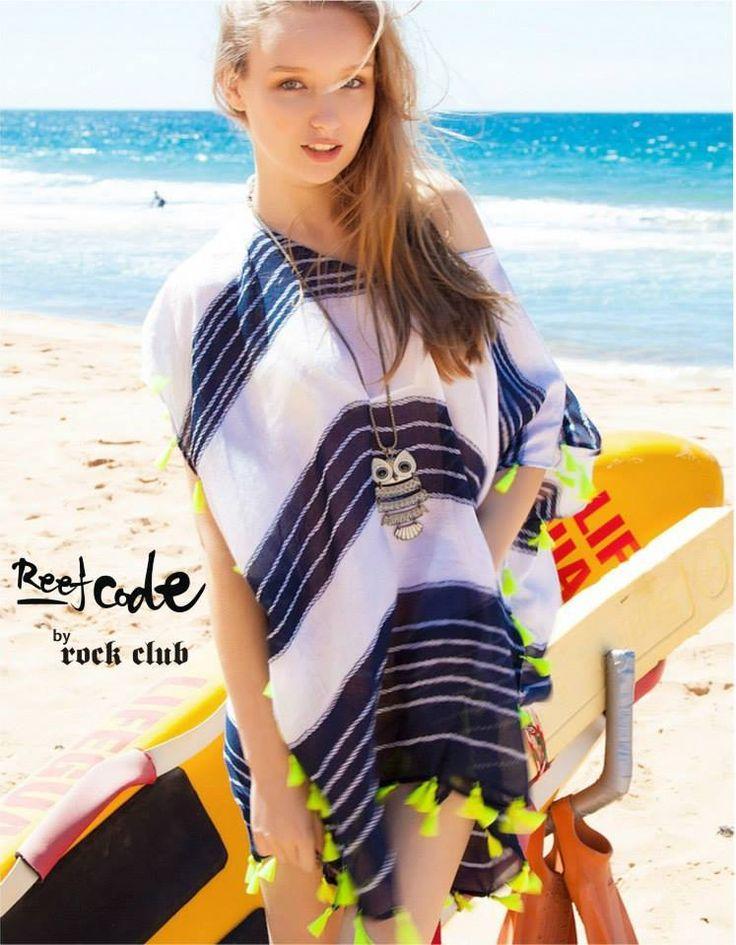 Beach kaftan with blue marine stripes and neon pom poms. Feel the summer breeze already?