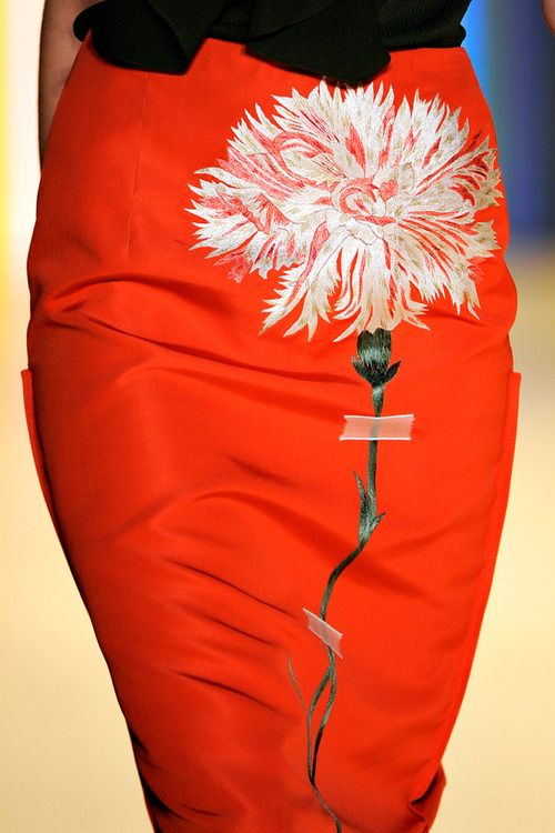 I don't really like this skirt - not my color of red, but I'm intrigued by the possibilities of the floral decoration.