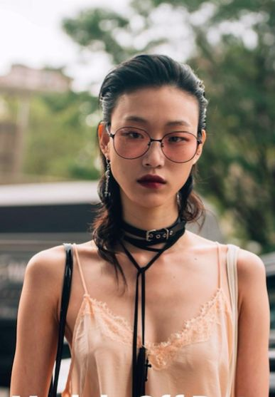 Korean model Sora Choi captured by our man Tommy Ton. Note the skinny scarf – September's answer to last season's choker. Check our Instagram stories for NYFW street style updates in real time. #styledotTon
