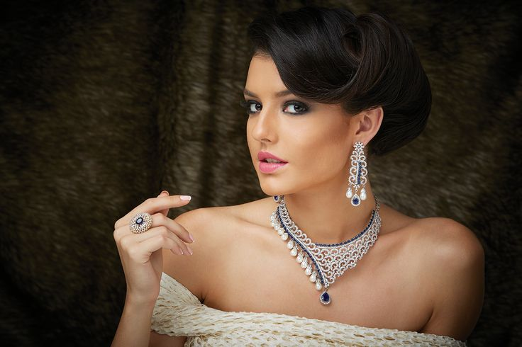 Necklace with Zircon stones in close setting and pearls with matching earrings