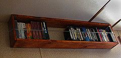 Use the wall space above the bed in RV for books & movies (and other organization tips)