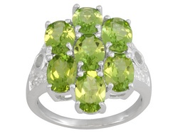 Manchurian Peridot 6.23ctw Round And .40ctw Round White Topaz Sterling Silver Ring