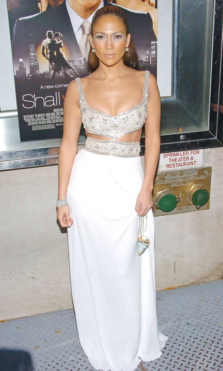 Jennifer Lopez  October 5, 2004   Playing a beautiful ballroom dance instructor in the film, the actress hit the red carpet for the New York premiere of Shall We Dance. Styling a white cut-out dress, Lopez proved that all that dancing paid off for her abs!  Read more: http://www.usmagazine.com/celebrity-body/pictures/jennifer-lopezs-hot-body-evolution-2013241/27811#ixzz3FmV9EFga Follow us: @usweekly on Twitter | usweekly on Facebook