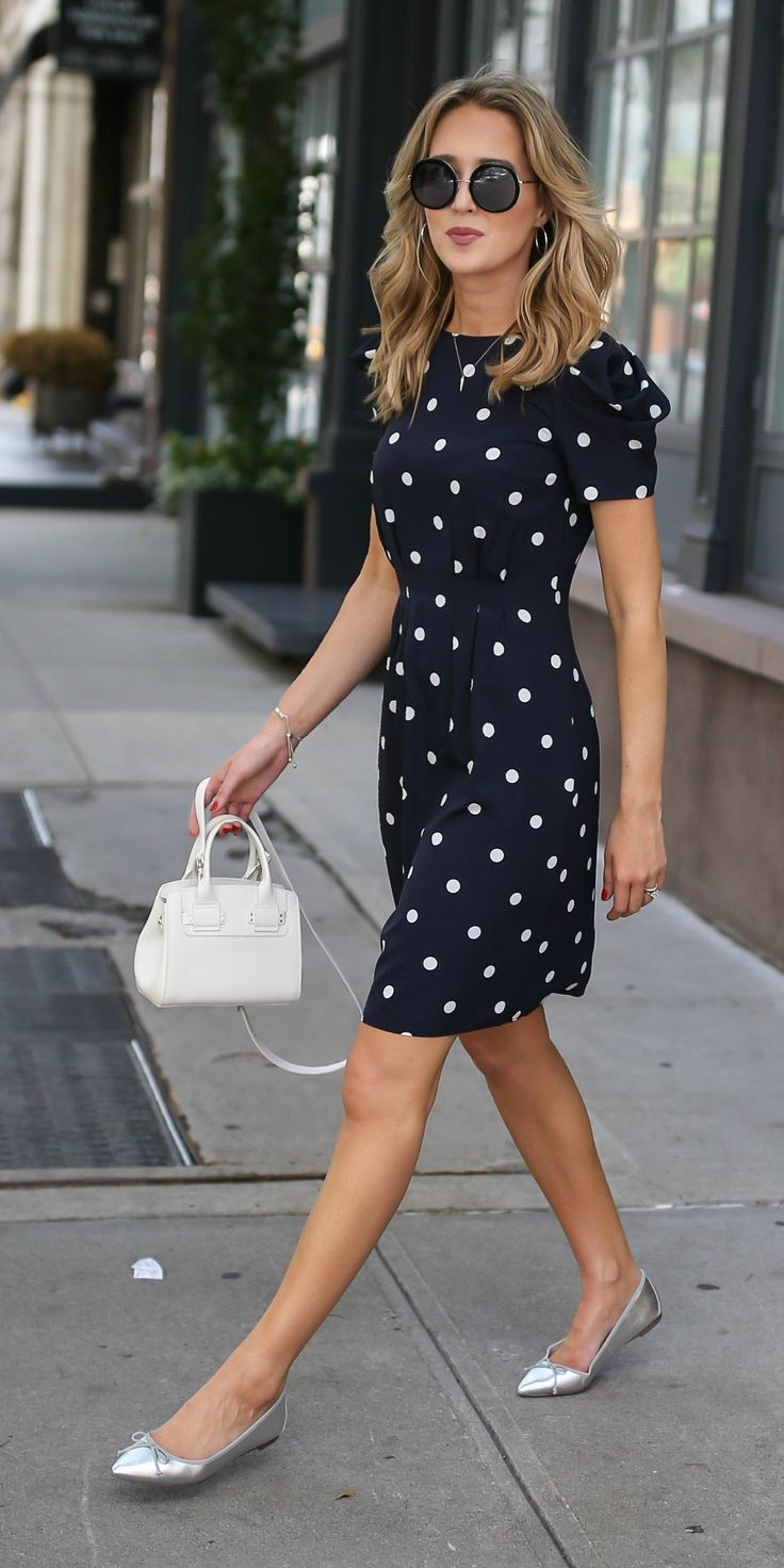 3 Day-To-Night Dresses You Need // Navy and white polka dot dress with shoulder detail and cinched waist + silver flats, white tote, and wavy hairstyle {Banana Republic + Furla}
