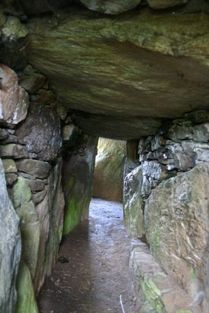 Bryn Celli Ddu.  is a prehistoric site on the Welsh island of Anglesey located near Llanddaniel Fab. Its name means 'the mound in the dark grove'. The Summer Solstice sun lights up a quartz stone at the back of the chamber.