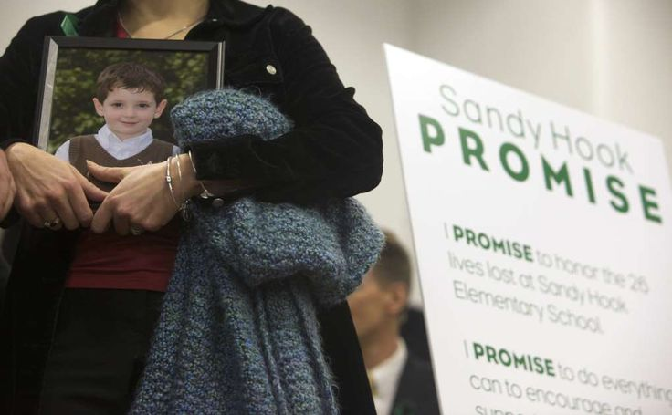 Since Sandy Hook, Congress Has Done Little on Guns  -  October 2, 2017:  Francine Wheeler holds a photo of her son, Benjamin Wheeler, a victim of the Sandy Hook Elementary School shooting, during the launch of Sandy Hook Promise, a nonprofit created in response to the shooting in Newtown, Connecticut, on January 14, 2012.: 1205_Sandy_Hook_Promise_PSA_01