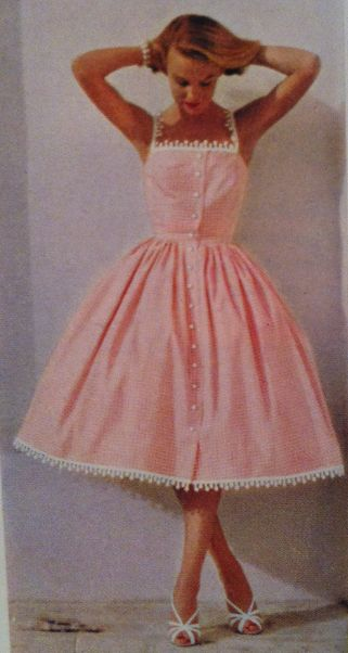 1950's buttoned shirtwaist dress, with edging at hem and neckline. Straps seem to be only lace. If I made it, I would have the edging material go all the way around the top instead of only across the bust.