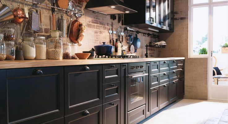 kitchen makeover: upcycle cabinets to black + new worktop and strip back wall to brick