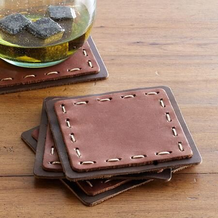 HUDSON COASTERS, SET OF 4 - A rustic, yet classy spot to stash your glass, our two-tone leather coasters feature whip stitch details.
