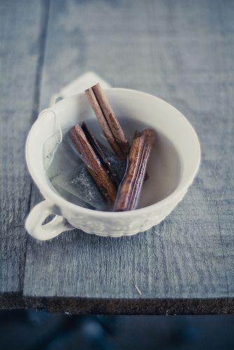 tea steeping with cinnamon sticks