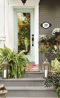 Love the blue door...so inviting! How great for a side door!