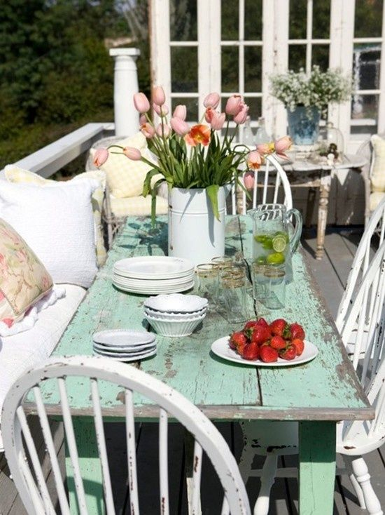 A nice large farmhouse table is a great beginning, extra distressing is compliments of Mother Nature. This shabby chic porch is a great place to gather and enjoy family and friends and was brought together by random pieces of furniture.