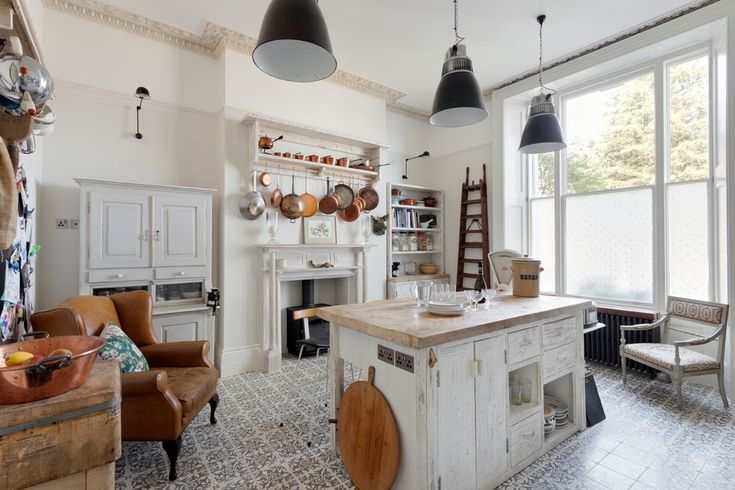 Eclectic shabby chic decor kitchen shabby-chic style with patterned floor tile saucepan rail