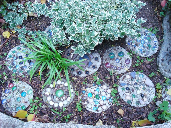 Mix up a small batch of mortar (which is cement mixed with an aggregate), pour into a plastic paper plate 'mold' and decorate with shiny marbles, beads, shells, etc. and let dry. Kids will feel so proud to have made something so beautiful, and will have so much fun discovering just the right home for their new artwork.
