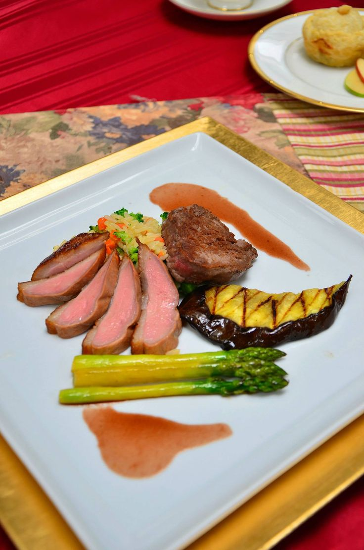 Arrosto di Anatra al Manzo -- Smoked Duck Breast and Beef Filet Duo with Sauce Bourdelaise Served with Broccoli Rice Pilaf, Grilled Eggplant, and Asparagus Tips