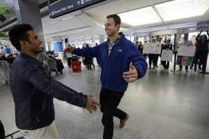 Army Capt. Matthew Ball, right, prepares to hug his former interpreter Qismat Amin, as Amin arrives from Afghanistan, at San Francisco International Airport, Feb. 8, 2017, in San Francisco. (AP Photo/Marcio Jose Sanchez) (Military.com article, 2016 article) - this was in the news again today.